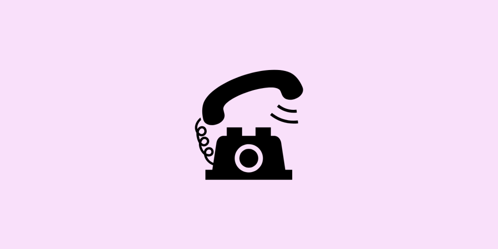 Telephone on a pink background